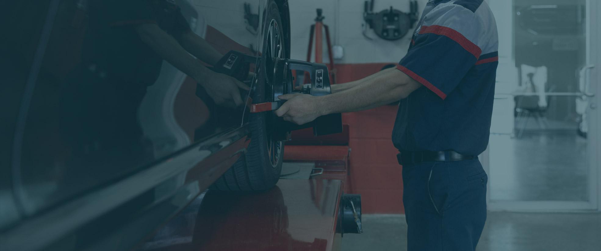 brakes plus employee working on car