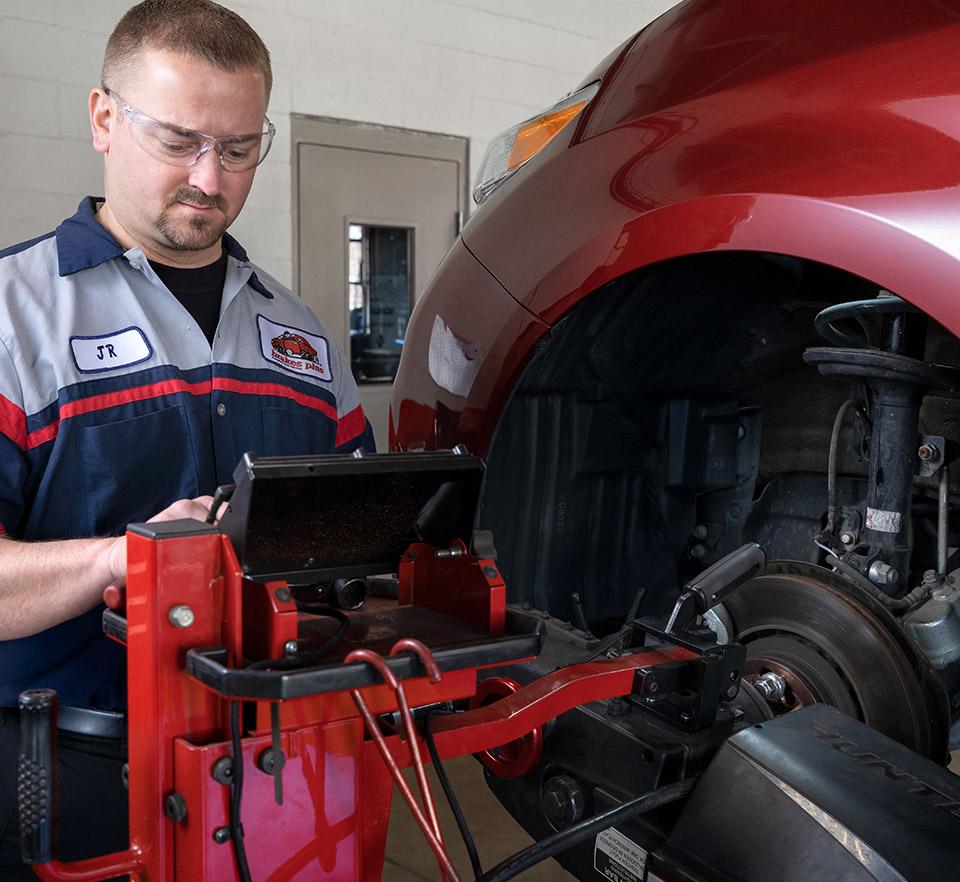 auto technician performing service on rotors