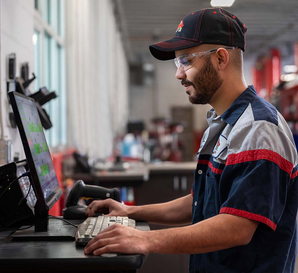 auto technician working on computer