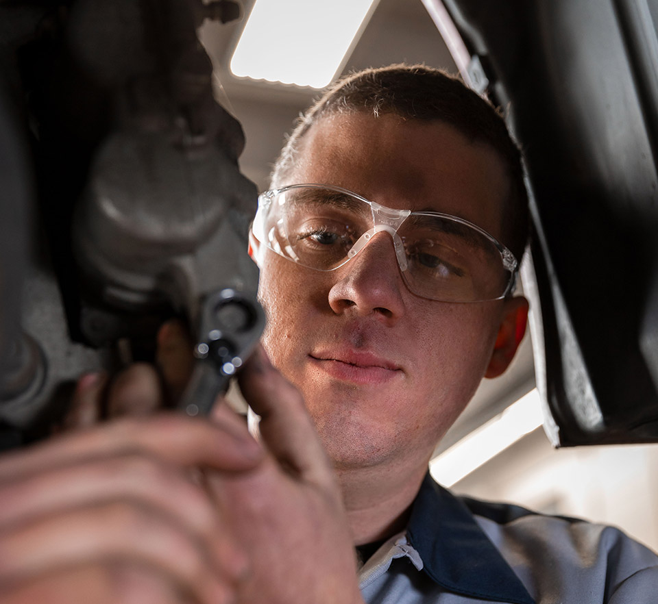 auto technician using wrench