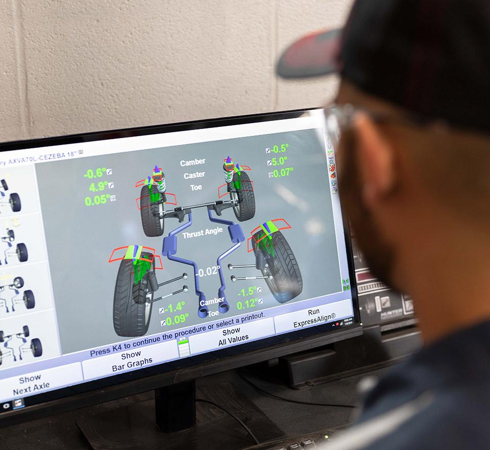 auto technician with computer screen